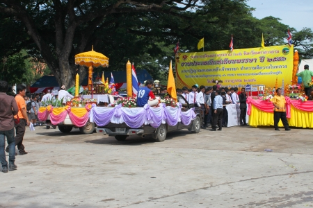 MAHASARAKHAM, THAILAND - JULY 19 : Unidentified people and pupils aged 7 - 10 years are participating in Buddhist Lent festival parade at city hall plaza on July 19, 2013 in Mahasarakham, Thailand.