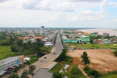 MUKDAHAN, THAILAND - JUNE 6 : View of Mukdahan business center at afternoon on June 6, 2013 in Mukdahan, Thailand. Mukdahan is also  city of Thai - Lao P.D.R. border business center, view from Mukdahan Tower.