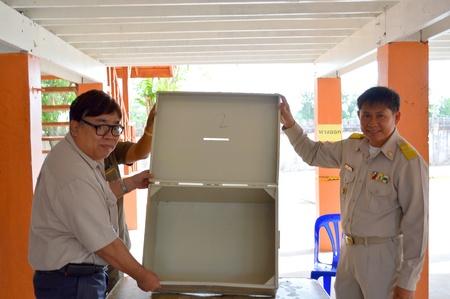 MAHASARAKHAM, THAILAND - APRIL 22 : Unidentified officers examine vote box in village headman election on April 22, 2013 in Ban Nong Weang, Muang, Mahasarakham, Thailand.