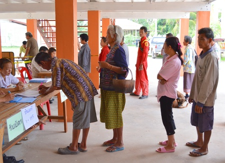 MAHASARAKHAM, THAILAND - APRIL 22 : Unidentified voters go to vote for village headman election on April 22, 2013 in Ban Nong Weang, Muang, Mahasarakham, Thailand.