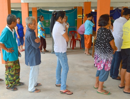 headman: MAHASARAKHAM, THAILAND - APRIL 22 : Unidentified voters go to vote for village headman election on April 22, 2013 in Ban Nong Weang, Muang, Mahasarakham, Thailand. Editorial