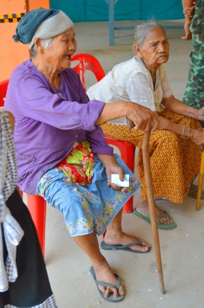 MAHASARAKHAM, THAILAND - APRIL 22 : Unidentified old women sit and wait to vote for village headman election on April 22, 2013 in Ban Nong Weang, Muang, Mahasarakham, Thailand.