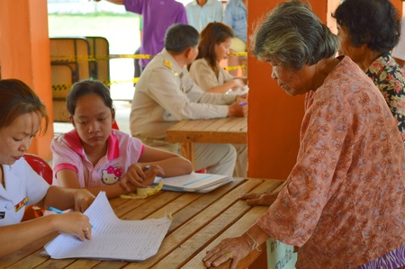 official ballot: MAHASARAKHAM, THAILAND - APRIL 22 : Unidentified voters go to vote for village headman election on April 22, 2013 in Ban Nong Weang, Muang, Mahasarakham, Thailand. Editorial