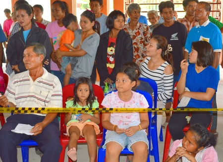 official ballot: MAHASARAKHAM, THAILAND - APRIL 22 : Unidentified children aged 4 - 10 years and voters wait to see result of village headman election counting on April 22, 2013 in Ban Nong Weang, Muang, Mahasarakham, Thailand.