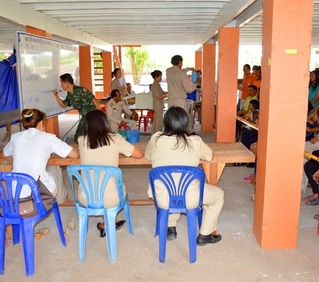 MAHASARAKHAM, THAILAND - APRIL 22 : Unidentified officers count and check result of village headman election on April 22, 2013 in Ban Nong Weang, Muang, Mahasarakham, Thailand.