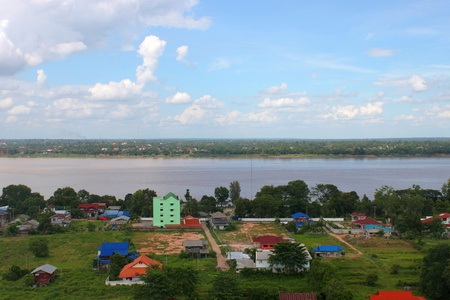 mid afternoon: MUKDAHAN, THAILAND - JUNE 6 : View of Mukdahan land and house area at afternoon on June 6, 2013 in Mukdahan, Thailand. Mukdahan is also  city of Thai - Lao P.D.R. border business center, view from Mukdahan Tower.