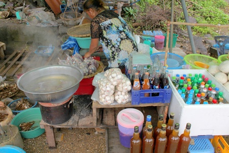 VANG TAO, LAO P D R  - JULY 28   Unidentified woman is selling food at Thai - Lao border business center on July 28, 2013 in Vang Tao, Lao P D R