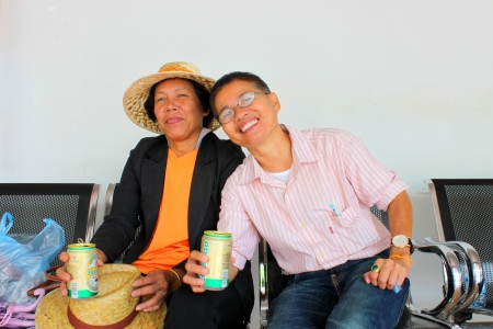 VANG TAO, LAO P D R  - JULY 28   Unidentified  women are drinking Beer Lao at Thai - Lao border business center on July 28, 2013 in Vang Tao, Lao P D R