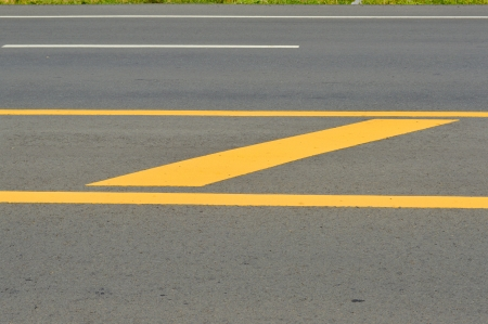 lines and signs on local asphalt road photo