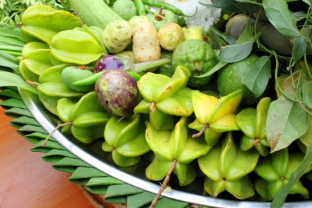 Northeastern Thai local vegetables and fruits in basket decoration Stock Photo - 21685984