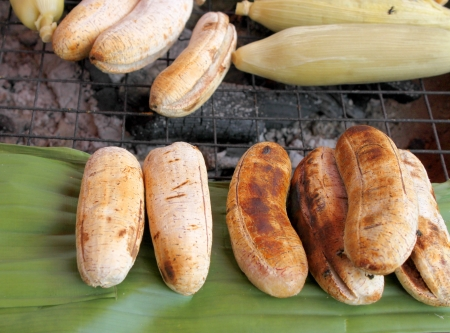 gridiron: Grilled cultivated banana and corn over gridiron and low heat from natural charcoal Stock Photo