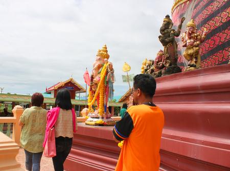 NAKORN NAYOK, THAILAND - SEPTEMBER 22   Unidentified tourists walk back and forth the big Ganesha statue at Ganesha Garden on September 22, 2013 in Nakorn Nayok, Thailand