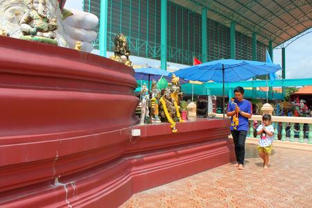 NAKORN NAYOK, THAILAND - SEPTEMBER 22   Unidentified man and girl aged 6 years walk back and forth the big Ganesha statue at Ganesha Garden on September 22, 2013 in Nakorn Nayok, Thailand