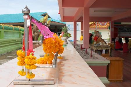 NAKORN NAYOK, THAILAND - SEPTEMBER 22   Unidentified tourists offer and worship the big Ganesha statue with flowers at Ganesha Garden on September 22, 2013 in Nakorn Nayok, Thailand