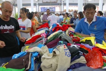 VIENTAINE, LAO P D R  - AUGUST 25   Unidentified tourists are buying clothes at duty free shop on August 25, 2013 in Vientaine, Lao P D R   Stock Photo - 22540934