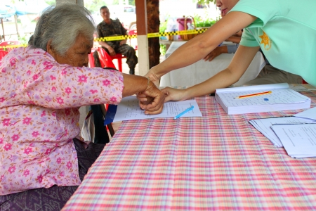 fingerprinted: MAHASARAKHAM - SEPTEMBER 14   Unidentified old woman is fingerprinted to vote for village headman election at Tha Rae Pattana on September 14, 2013 in Muang, Mahasarakham, Thailand