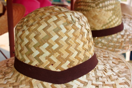 handmade straw hats on sale in market photo