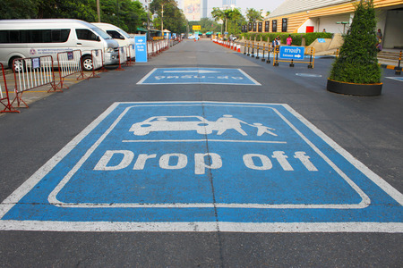 drop off: BANGKOK - OCTOBER 26   Drop off sign is painted on the road in front of Queen Sirikit National Convention Center on October 26, 2013 in Bangkok, Thailand
