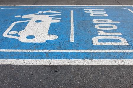 drop off: drop off painting on local asphalt road