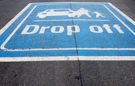 drop off: drop off painting on local asphalt road