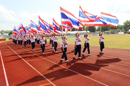 MAHASARAKHAM - NOVEMBER 8   Unidentified university students are marching along athletic ground in 12 th Ti Cup closing ceremony on November 8, 2013 in Mahasarakham, Thailand