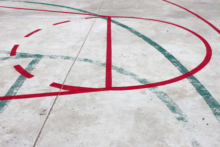 overlapped: overlapped lines in concrete basketball court