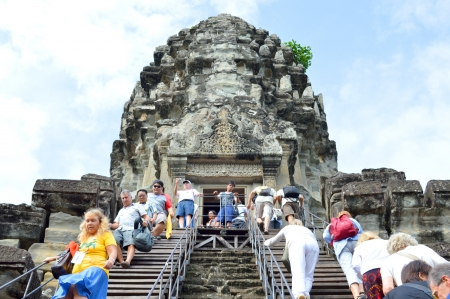 handscraft: SIEM REAP, CAMBODIA - NOVEMBER 24   Unidentified tourists get up to top level of ancient temple and the most visited historic UNESCO World Heritage site, Angkor Wat on November 24, 2013 in Siem Reap, Cambodia  Editorial