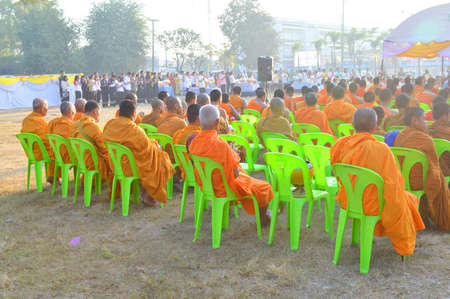 MAHASARAKHAM - DECEMBER 5   Buddhist monks wait for give food offerings in celebration of the king