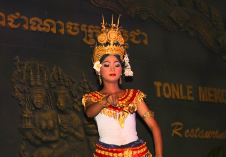 SIEM REAP, CAMBODIA - NOVEMBER 23   Unidentified woman performs cultural dancing show at Tonle Mekong Restaurant on November 23, 2013 in Siem Reap, Cambodia   Editorial