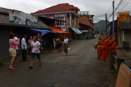 VANG VIENG, LAO P D R  - AUGUST 25   Monks ask for alms at traditional morning market on August 25, 2013 in Vang Vieng, Lao P D R