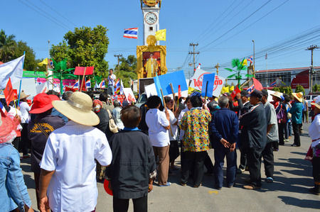 MAHASARAKHAM, THAILAND - January 13   Political supporters march through city clock tower to campaign for votes and election on January 13, 2014 in Mahasarakham, Thailand   Editorial