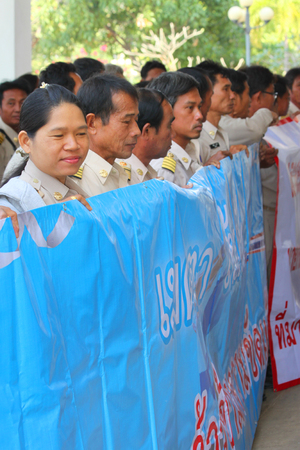 civil disorder: MAHASARAKHAM, THAILAND - DECEMBER 2   Political supporters march through governor