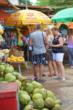 ka: KA LAN, CAMBODIA - NOVEMBER 24   Tourists are buying food and drink at local market on November 24, 2013 in Ka Lan, Cambodia