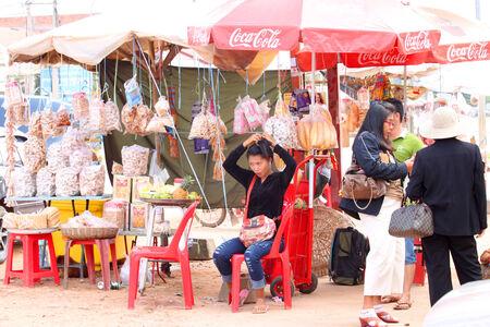 ka: KA LAN, CAMBODIA - NOVEMBER 23   Unidentified Khmer woman is selling foods at local market on November 23, 2013 in Ka Lan, Cambodia