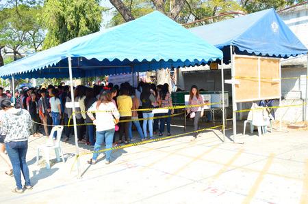 congressman: MAHASARAKHAM, THAILAND - FEBRUARY 2   People gather round for general election at  Rajabhat University polling station on February 2, 2014 in Mahasarakham, Thailand  Editorial