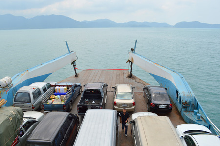 TRAT, THAILAND - FEBRUARY 27   Cars are loaded on ferry boat and heading to Koh Chang island on February 27, 2014 in Koh Chang, Trat, Thailand  Koh Chang is the country