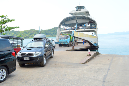 TRAT, THAILAND - FEBRUARY 27   Cars are moved out off ferry boat at Koh Chang island quay on February 27, 2014 in Koh Chang, Trat, Thailand  Koh Chang is the country