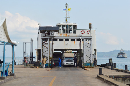 TRAT, THAILAND - FEBRUARY 28   Cars are moved out off ferry boat at Koh Chang island quay on February 28, 2014 in Koh Chang, Trat, Thailand  Koh Chang is the country
