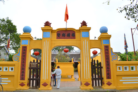 communual: HOI AN, VIET NAM - MARCH 15   Tourists visit Cam Pho Temple on March 15, 2014 in Hoi An, Viet Nam  Hoi An is world heritage old town with old aged traditionally kept cultural activities, habits and customs