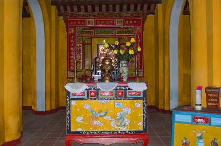 communual: HOI AN, VIET NAM - MARCH 15   Set of altar table is placed in Cam Pho Temple on March 15, 2014 in Hoi An, Viet Nam  Hoi An is world heritage old town with old aged traditionally kept cultural activities, habits and customs
