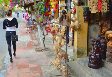 communual: HOI AN, VIET NAM - MARCH 15   Tourists visit and shopping at walking street on March 15, 2014 in Hoi An, Viet Nam  Hoi An is world heritage old town with old aged traditionally kept cultural activities, habits and customs