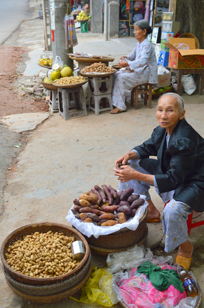HUE, VIETNAM - MARCH 15   Merchants are selling foods and fruits at Thien Mu temple  footpath market stall on March 15, 2014 in Hue, Vietnam