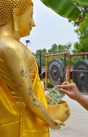 money donation for Buddhist religious merit  photo