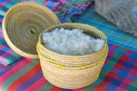 Kratip or sticky rice utensil on cotton clothes photo