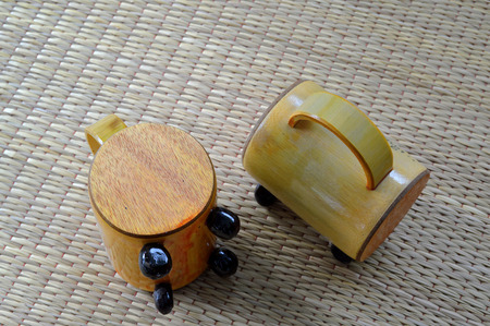 piggy bank or money box made of bamboo wood on woven dried sedge mat photo