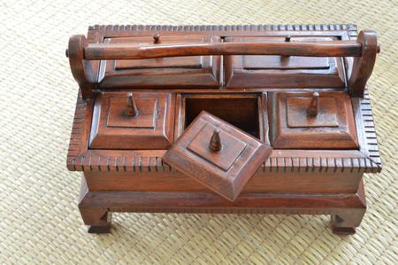 multipurpose: multi-purpose wooden box on woven sedge mat Stock Photo