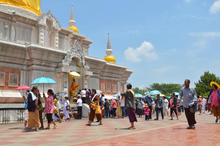 rite: NADUN, MAHASARAKHAM - MAY 13   Thai people participate in Buddhist light waving rite and make religious merit at Nadun pagoda on May 13, 2014 in Nadun, Mahasarakham, Thailand