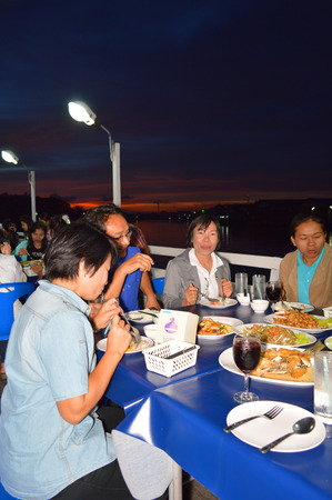 RAYONG - SEPTEMBER 21 : Tourists have dinner at Laem Cha-roen Seafood on September 21, 2014 in Rayong, Thailand. This is delicious seafood restaurant in east sea since 1979.