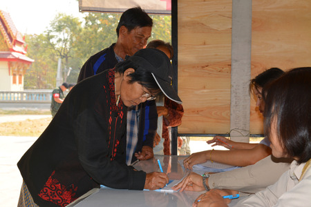 free vote: MAHASARAKHAM - JANUARY 29 : Old woman goes to vote for village headman election at Ban Nong Hin on January 29, 2015 in Muang, Mahasarakham, Thailand. Editorial