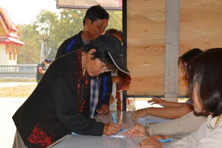 headman: MAHASARAKHAM - JANUARY 29 : Old woman goes to vote for village headman election at Ban Nong Hin on January 29, 2015 in Muang, Mahasarakham, Thailand. Editorial